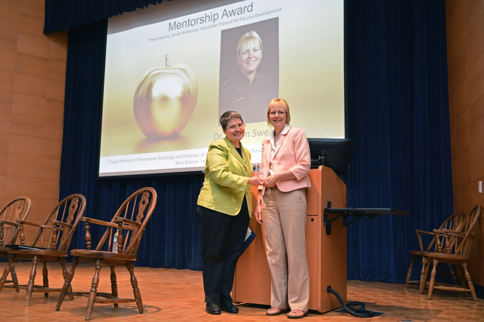 Karen Anderson (left), associate provost for academic resources and faculty development, presents the Postdoctoral Mentoring Prize to Joann Sweasy at the ceremony on Sept. 19. (Photo by Michael Marsland)